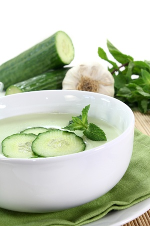 cold cucumber soup with slices of cucumber and mint Standard-Bild