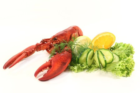 a lobster with salad, orange and cucumber photo