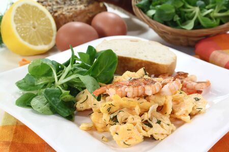 Scrambled eggs with shrimp, dill and corn salad on a plate Stock Photo - 12374724