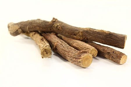 some pieces of licorice on a white background