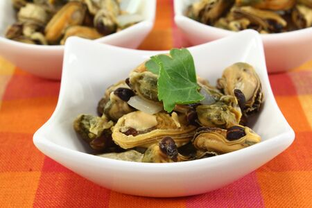 a bowl of marinated mussels and parsley Stock Photo - 13043060