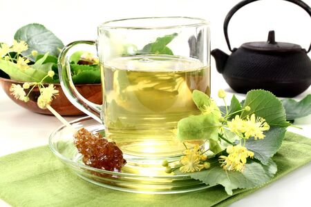 lime blossom: a cup of lime blossom tea with fresh flowers
