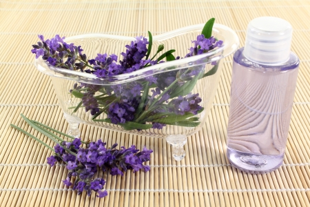 a bath tub with lavender flowers and lavender oil photo