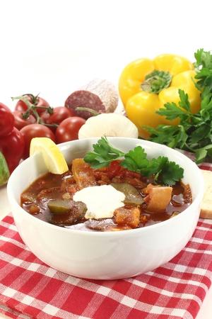 solyanka: a bowl Solyanka with cream and lemon