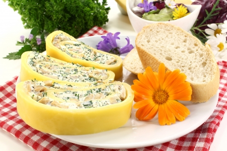 filled roll: Cheese roll filled with herb cream cheese and mushrooms Stock Photo