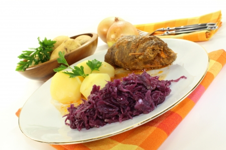 red braised: braised beef roll with potatoes and red cabbage