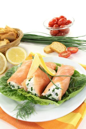 Salmon rolls with cream cheese and chives photo