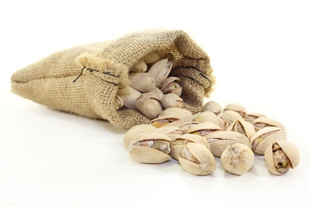 foodies: roasted, salted pistachios on a white background