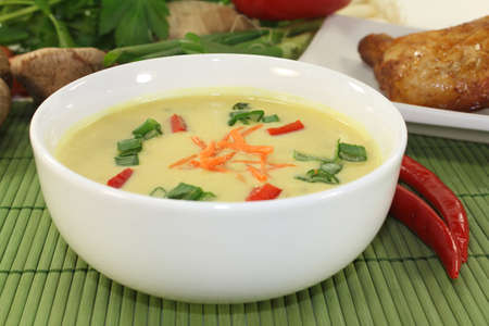 Curry soup with colorful vegetables and chicken Stock Photo
