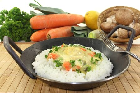 fricassee: a pan with rice and colorful chicken fricassee Stock Photo