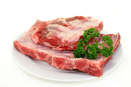 two pieces of spare ribs on a white background photo