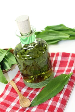 tincture: a bottle garlic tincture on a white background Stock Photo