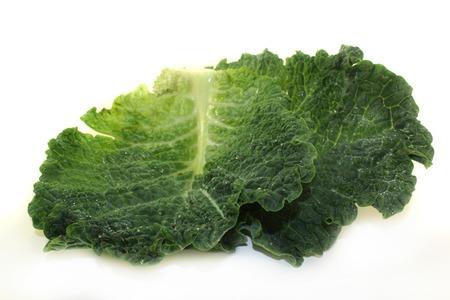 savoy cabbage: a fresh green savoy cabbage on white background