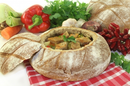 a farmhouse bread stuffed with a colorful bread soup