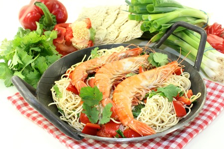 mie noodles: Black tiger prawns on Mie noodles with vegetables Stock Photo