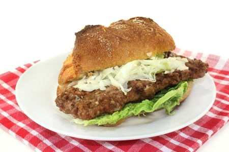 a bun with salisbury steak, coleslaw and salad photo