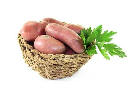 viands: raw, red potatoes on a white background