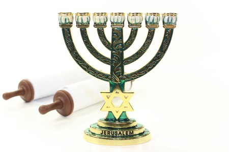 tora: Jewish candlestick and Torah scroll in front of white background