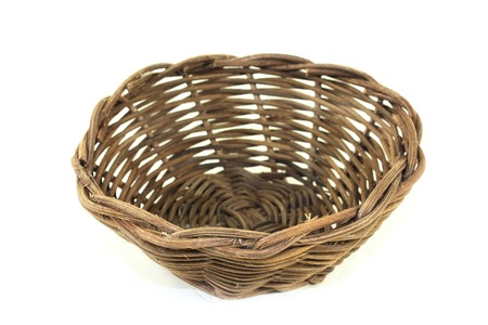 basket weaving: braided wicker basket against a bright background