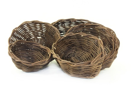 braided wicker baskets against a bright background Stock Photo