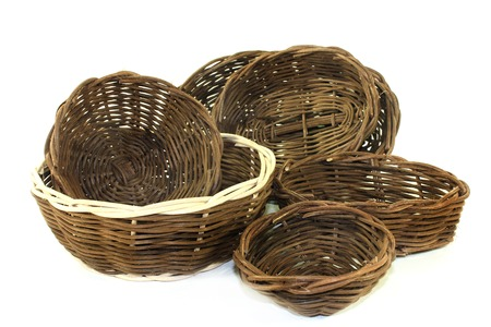 basket weaving: braided wicker baskets against a bright background Stock Photo