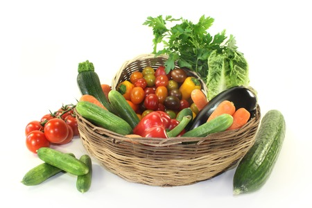 carots: different types of vegetables in a basket