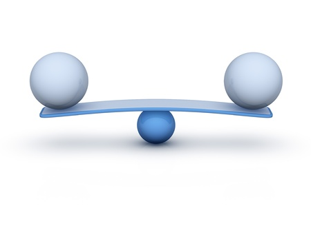two spheres on seesaw balance concept photo
