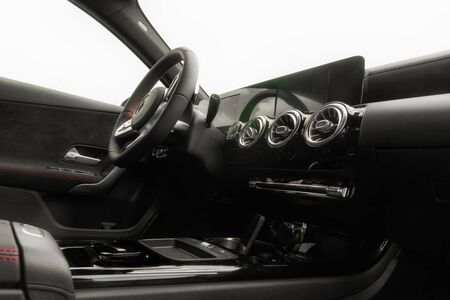 Black interior in the front of a sports car