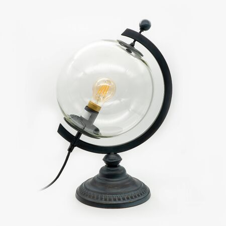 A glass globe lamp with a metal base, cut out on white background