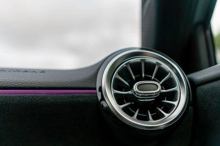 A close up of a ventilation nozzle in a modern sport car