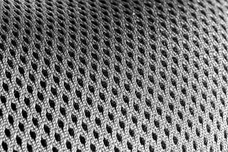 Macro shot of a mesh-like undulating gray silver surface Stok Fotoğraf - 148205647