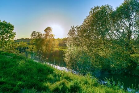 An idyllic evening landscape on a small river