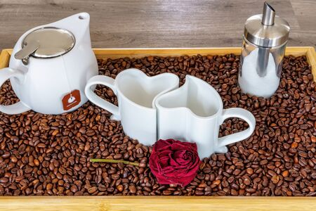 An arrangement of heart cups on a tray with coffee beans Stok Fotoğraf