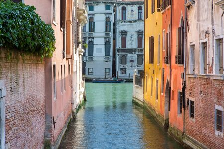A row of houses on the canal in the middle of Venice Stok Fotoğraf