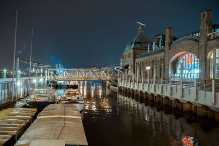 A small dock at night with colored lights in Hamburg Stok Fotoğraf - 149880042