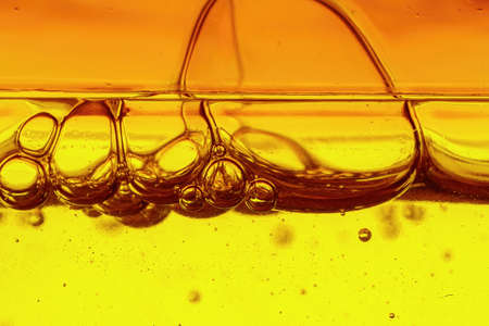 A viscous yellow liquid with air bubbles, macro shot Stok Fotoğraf - 152612277