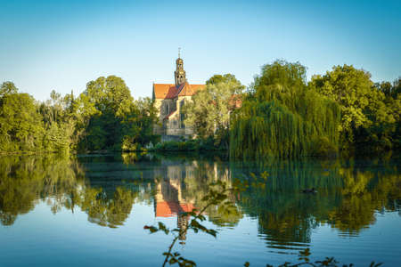 An old monastery in an idyllic atmosphere on a lake in sunshine