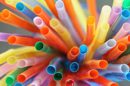 Close up of colorful straws photographed from above, studio shot