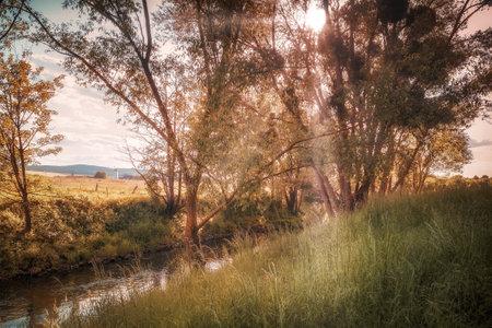 A beautiful orange sunset on a small river