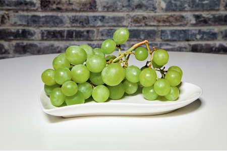 Grapes on a heart shaped plate, studio shot