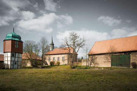An old monastery courtyard with a bank and a small chapel, outdoor shot. Stok Fotoğraf