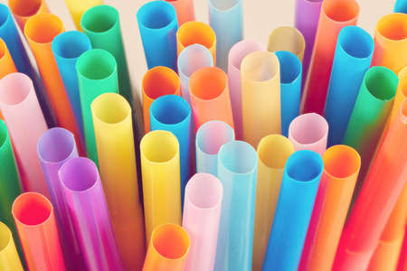 Close up of colorful straws photographed from the front, studio shot