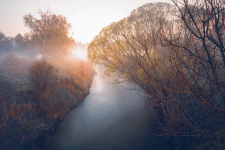 A beautiful orange sunset on a small river, dreamy atmosphere