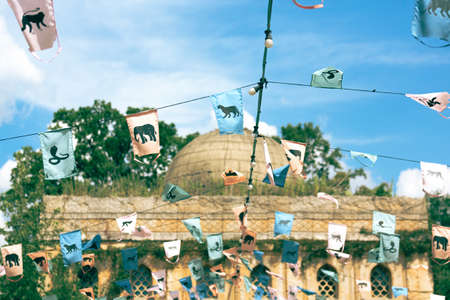 Indian prayer flags hang strung in the air