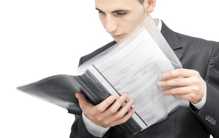 Young business man reading a contract Stock Photo - 9832599