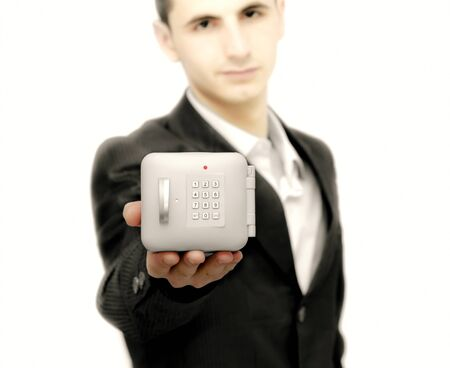 Young business man with a safe in right hand Stock Photo - 9832346