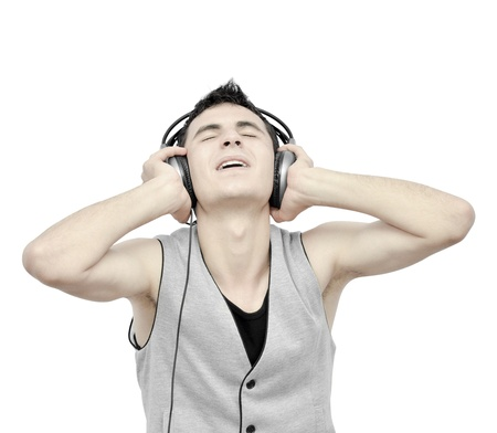 Teenager listening music on headphones Stock Photo - 9832729