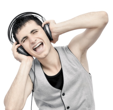 Teenager listening music on headphones  Stock Photo - 9832754