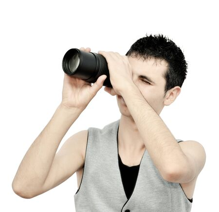 Young man looking through the lens Stock Photo - 9832605