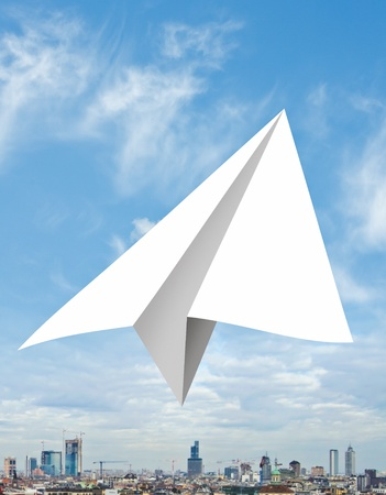Concept with paper aircraft flying on the sky photo